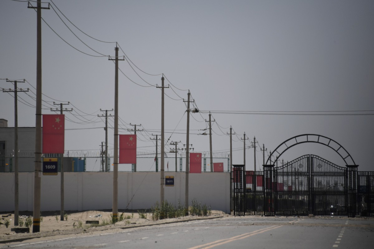 Chinese flags line a road leading to a facility believed to be a re-education camp where Muslim ethnic minorities are detained on the outskirts of Hotan in Xinjiang. Photo: AFP