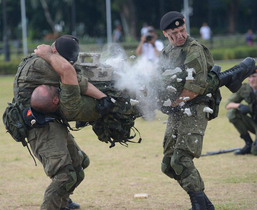 A marine breaks breezblocks across his stomach.