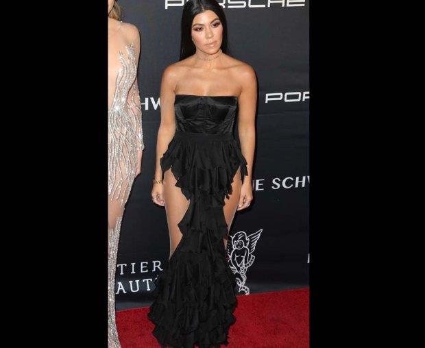 Kourtney Kardashian wears a revealing optical illusion dress