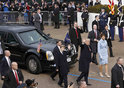 US President Donald Trump waves as he and his wife Melania walk during the inaugural Parade.