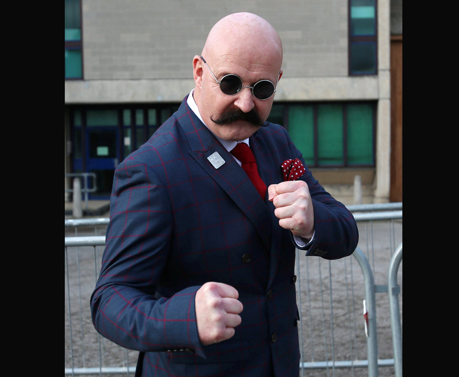 A chauffeur - and Bronson lookalike - poses for a photo at Wakefield prison