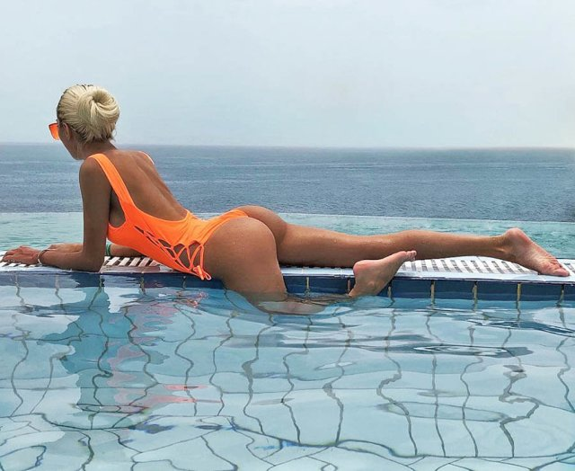 A woman strikes a pose in a luxury pool