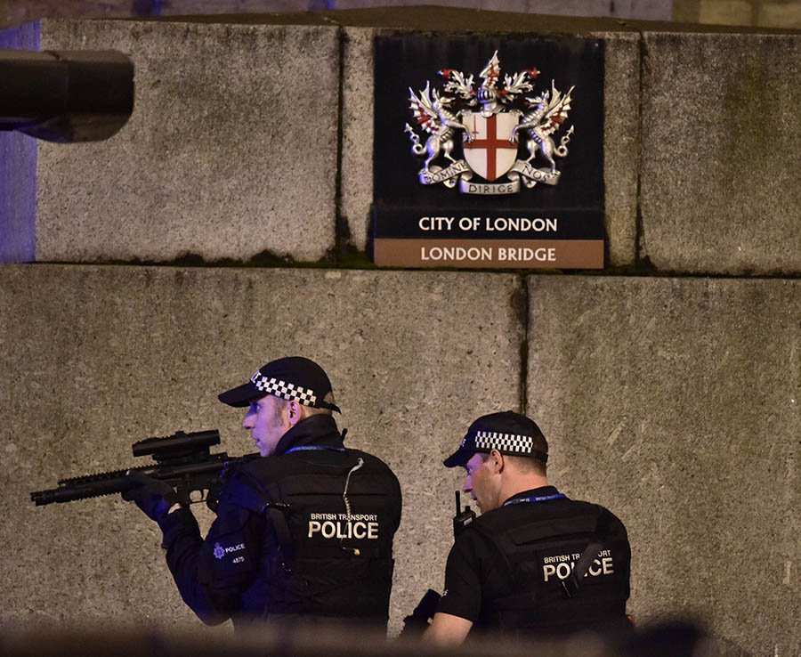 Armed Police search near London Bridge ready to fire
