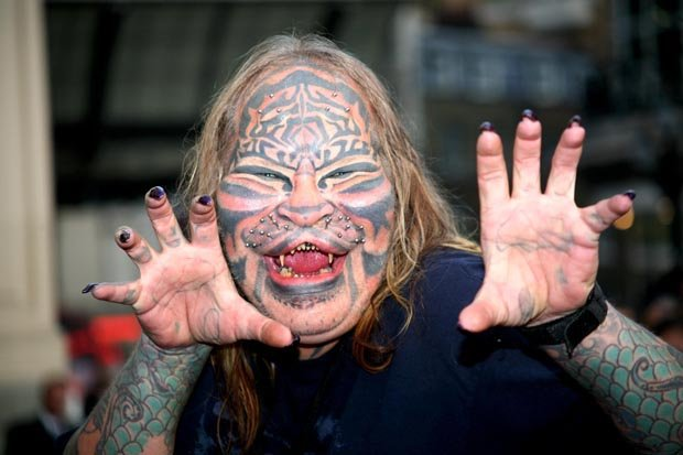 Catman had whiskers implanted into his cheeks and sharpened his teeth to resemble tiger fangs
