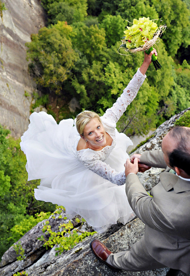 Newlywed Couple Hang Off Cliff In Most Daring Wedding