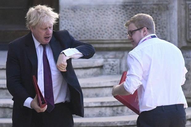 Mr Johnson stared at his watch as he left the Foreign Office to walk to a cabinet meeting at number 10