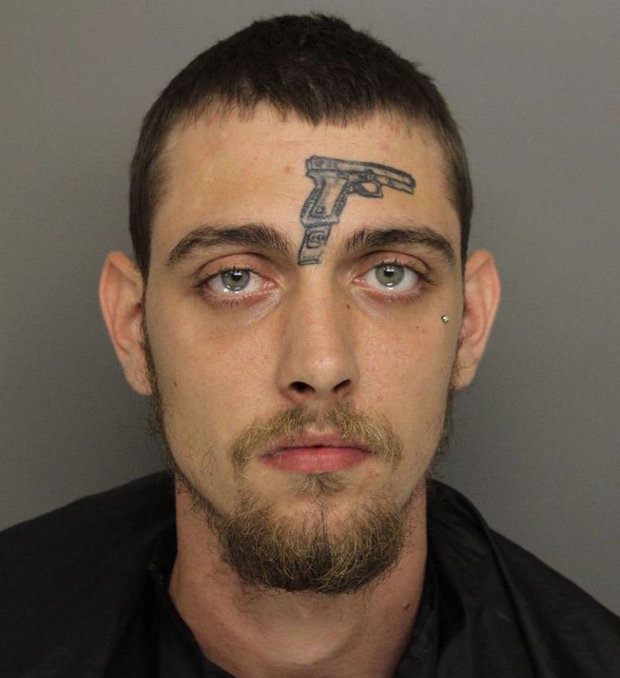Man With Gun Tattoo On His FOREHEAD Charged With