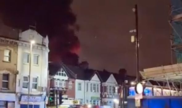 Horror as thick plume of black smoke fills sky - huge blaze causes panic in north London