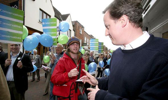 David Cameron being stopped by a charity worker