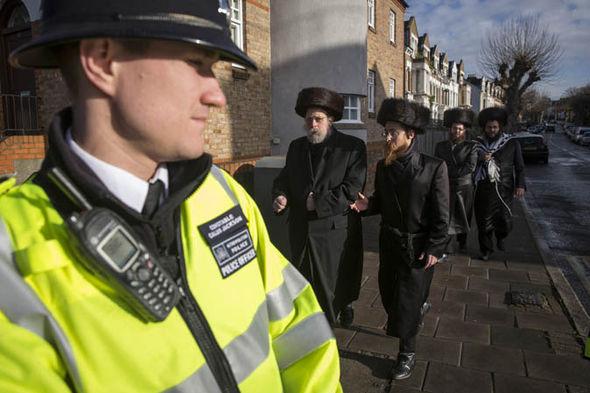 A policeman with Orthodox Jews