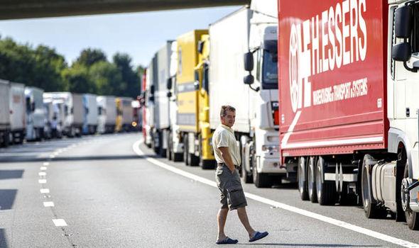 Man waits on motorway during m20 queue