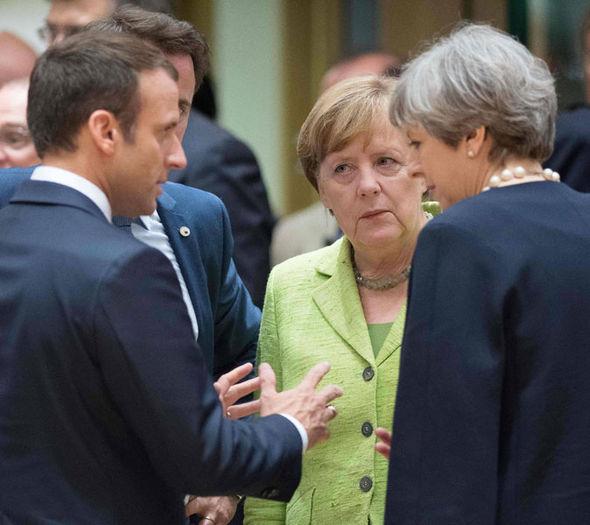 Macron, May and Merkel chat before meetings at the EU summit