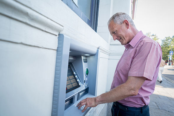 Man getting cash out of ATM
