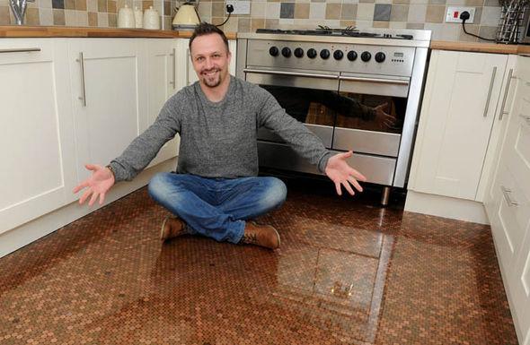 Matt Giles shows his new kitchen floor
