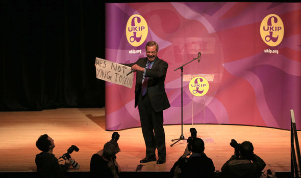 Nigel Farage with a sign