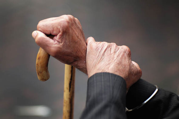 Pensioner holding a walking stick