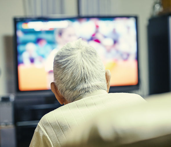Pensioner watching TV