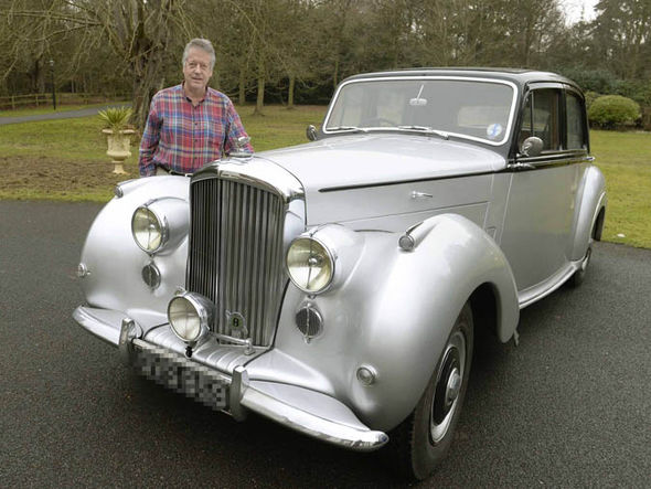 Peter Stirling standing next to his Bentley