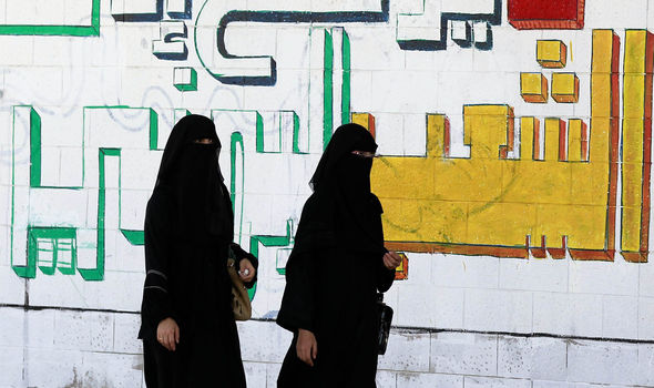 Two women walking in Saudi Arabia