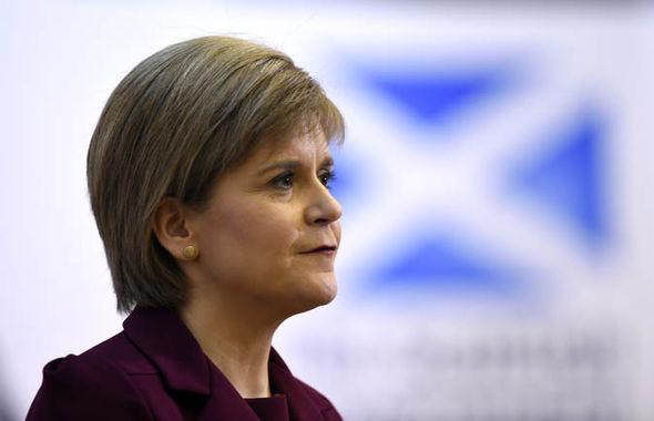 Nicola Sturgeon with a Scottish flag
