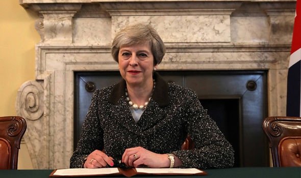 Theresa May signed the doument to begin Brexit talks on Tuesday