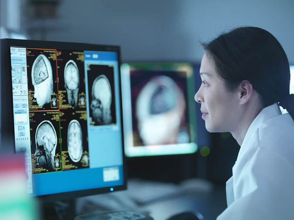 A doctor looking at a brain scan