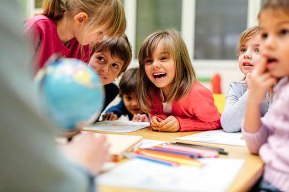 Nursery children laughing
