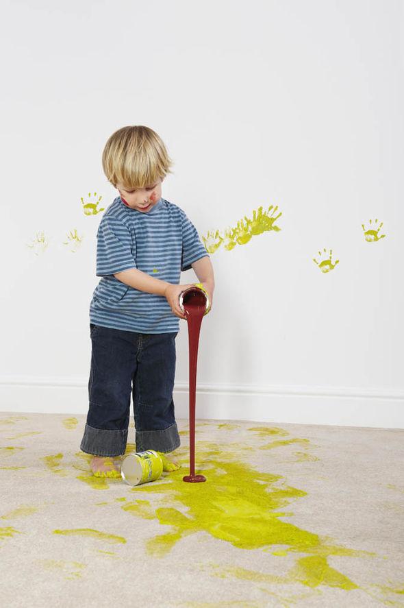 Boy pouring paint