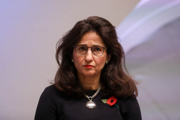 Dame Minouche Shafik with a poppy