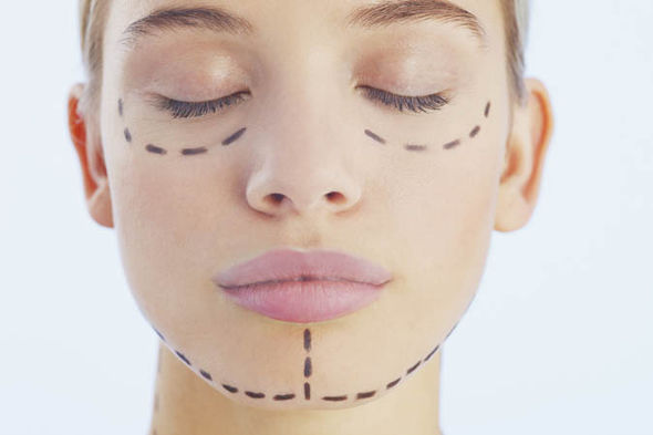 Woman with lines drawn on her face