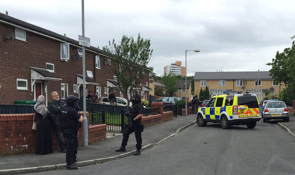 Armed police around Moss Side
