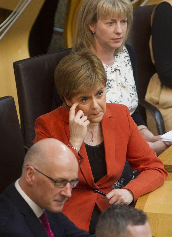 Nicola Sturgeon scratching her eye