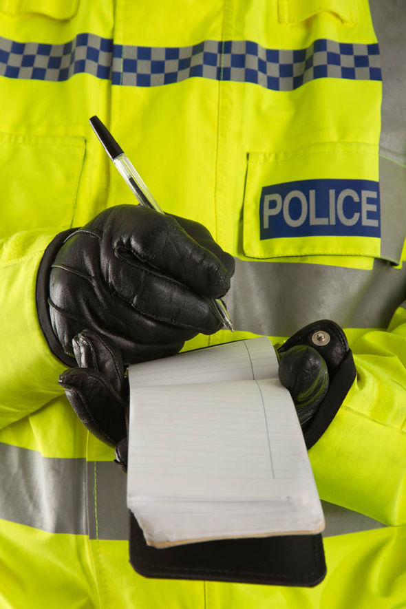 Police officer writing something down