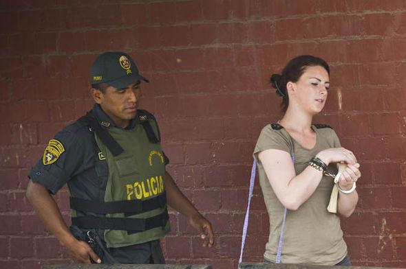 Michaella McCollum escorted by a guard