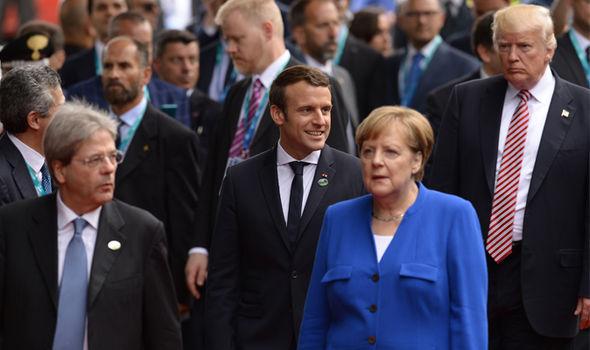 Emmanuel Macron and Angela Merkel (centre)
