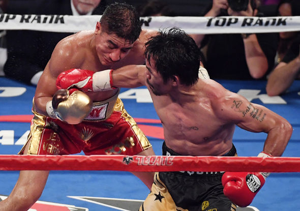 Boxers Manny Pacquiao and Jessie Vargas in action