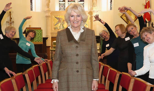 The Duchess of Cornwall with people around her
