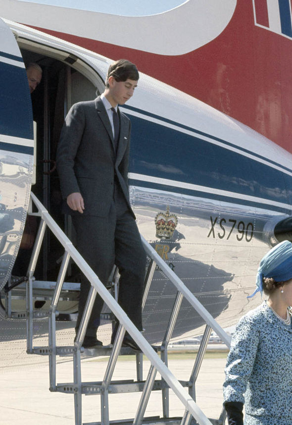 Prince Charles walking off an airplane