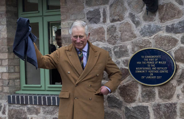 Prince Charles with a sign
