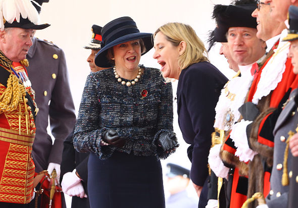 Amber Rudd and Theresa May share a joke ahead of an audience with the Queen