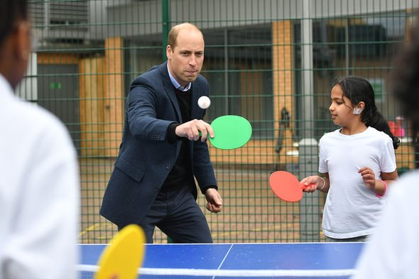 Prince William, Duke of Cambridge plays table tennis during a visit to The Way Youth Zone on May 13, 2021 in Wolverhampton, England