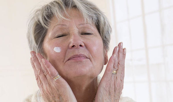Senior woman wearing face cream