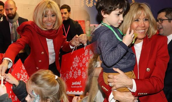 Brigitte Macron handed gifts to children