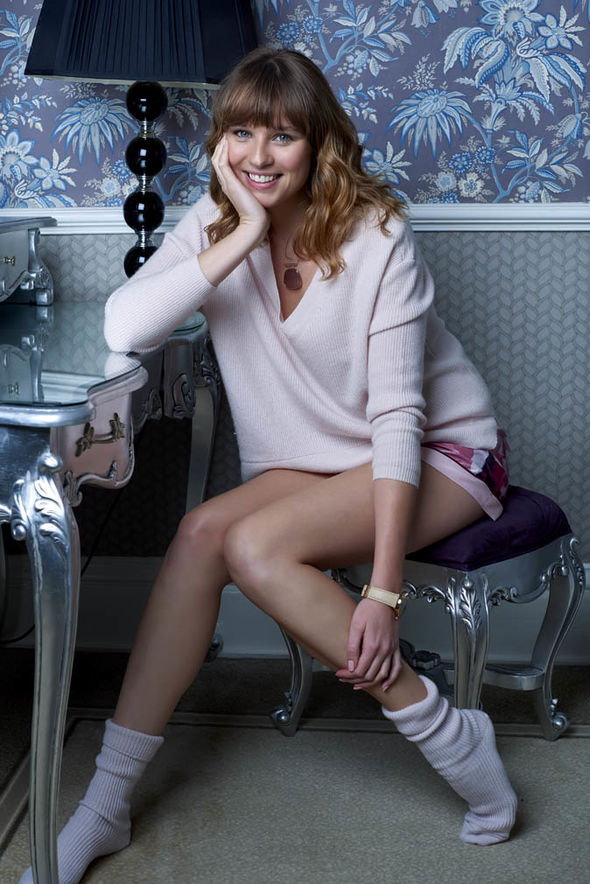 model sitting wearing cashmere socks and sweater  Loungewear sets from Mint Velvet, Debenhams | Style | Life & Style marks and spencer cashmere socks print shorts 1191090