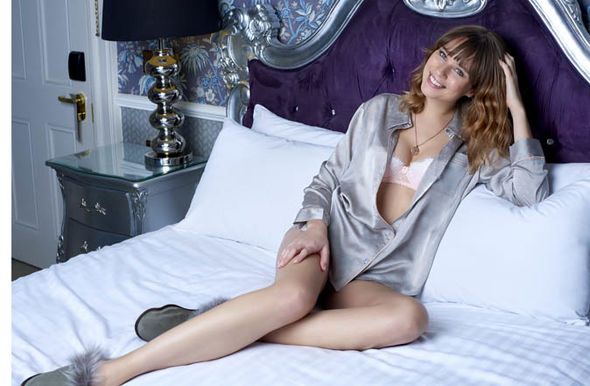 model reclining on bed in pyjamas   Loungewear sets from Mint Velvet, Debenhams | Style | Life & Style paisley print pyjamas silk set 1191072