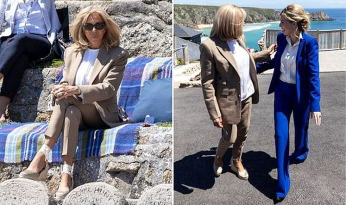 Chic Brigitte Macron in suit and espadrilles as she attends theatre performance