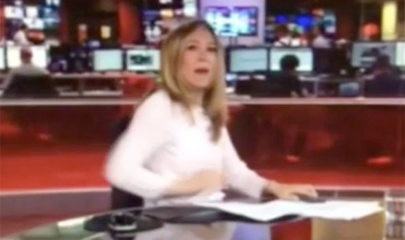 BBC news reporter caught playing with her phone live on ...