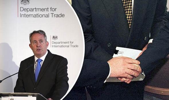 Liam Fox, Secretary for International Trade (left)