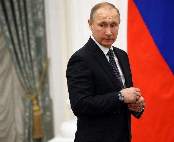 Vladimir Putin by a Russian flag