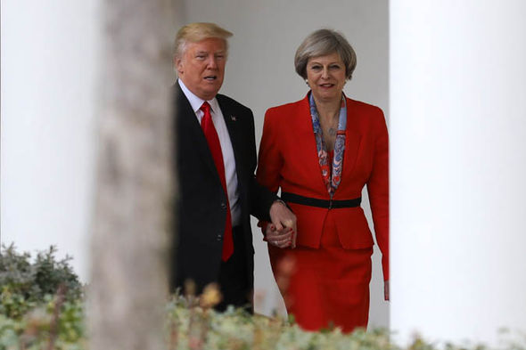 Donald Trump and Theresa May holding hands